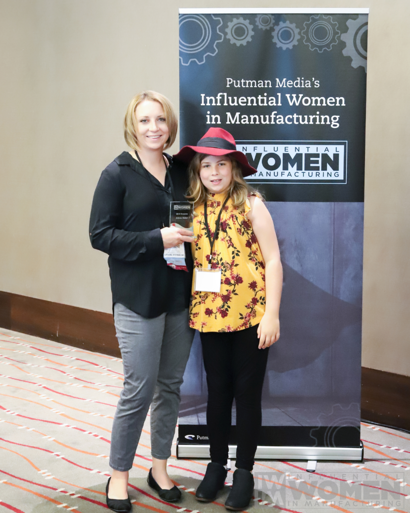 Jolene Baker and her daughter at the IWIM breakfast