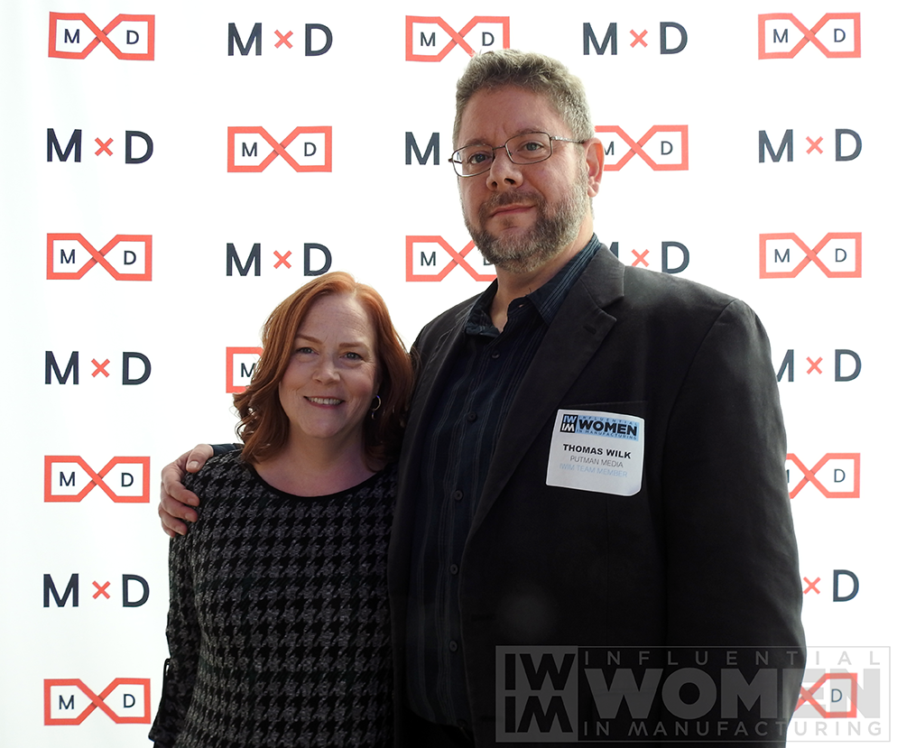 Lori Ditoro of SEPCO (left) and Tom Wilk of Putman (right) pose for a portrait at the 2019 Influential Women in Manufacturing awards luncheon on Oct. 4 at MxD.