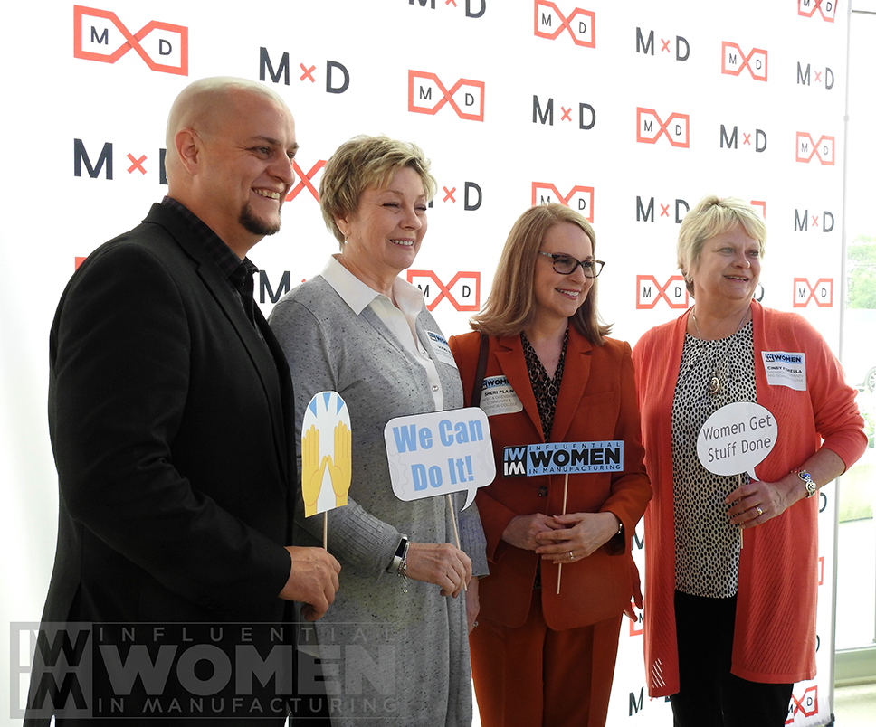 Jason Simon (right), Vicki Boyd (right center), 2019 IWIM honoree Sheri Plai (right center) and Cindy Fiorella (right), all of Owensboro Community and Technical College, pose for a portrait at the 2019 Influential Women in Manufacturing awards luncheon at MxD.