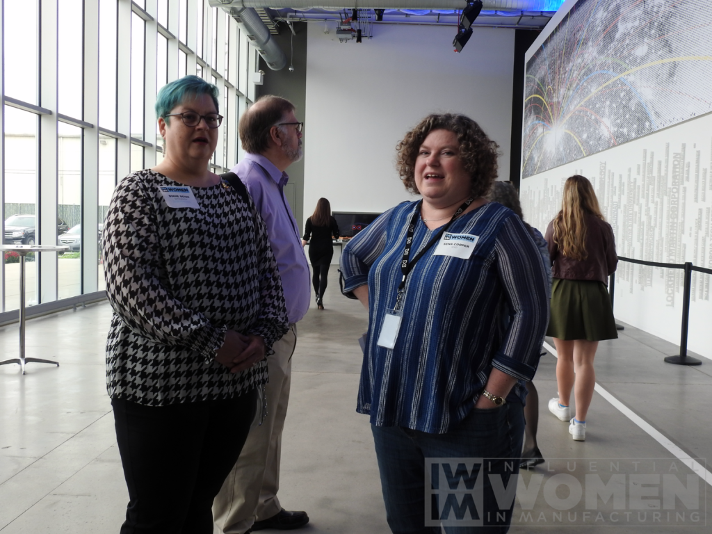 2019 Influential Women in Manufacturing honoree Diane Doise of Syngenta (left) and Sena Cooper of MxD (right) catch up before the awards luncheon begins at MxD on Oct. 4.