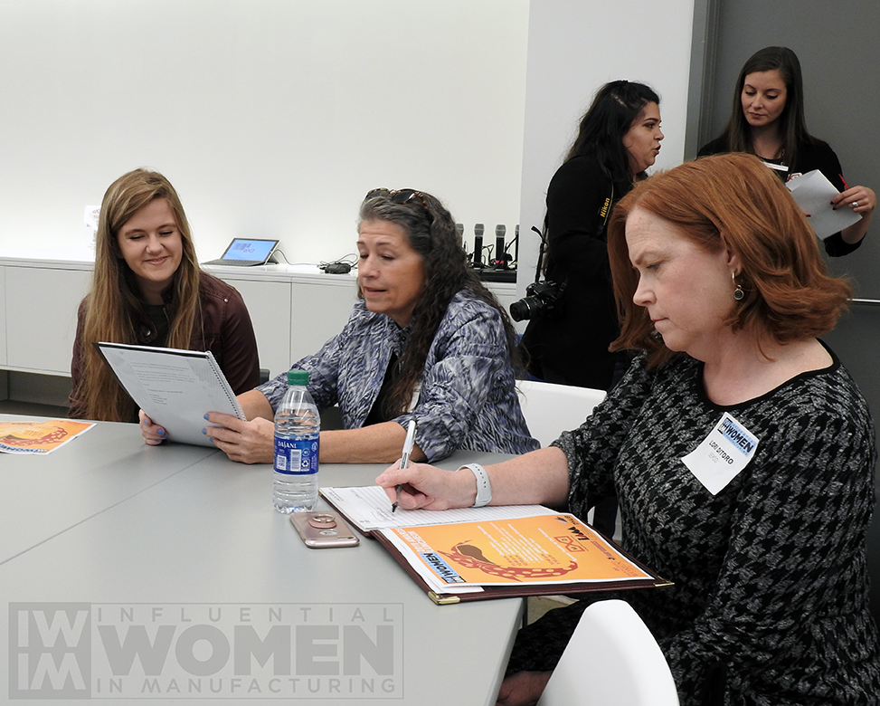 2019 IWIM honoree Linda Miller of PDT, Inc. (middle) sits alongside her daughter (left) and Lori Ditoro of SEPCO (right) before the 2019 Influential Women in Manufacturing awards luncheon on Oct. 4, held at MxD.