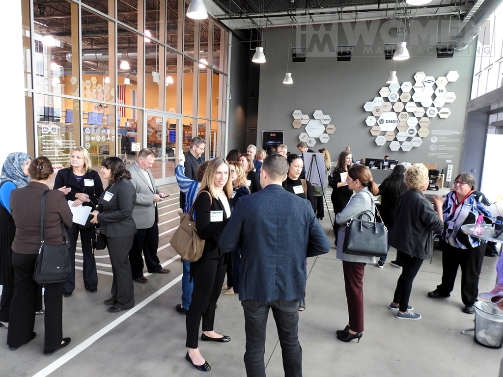 Guests mingle before the 2019 Influential Women in Manufacturing awards luncheon begins at MxD on Manufacturing Day, Oct. 4.