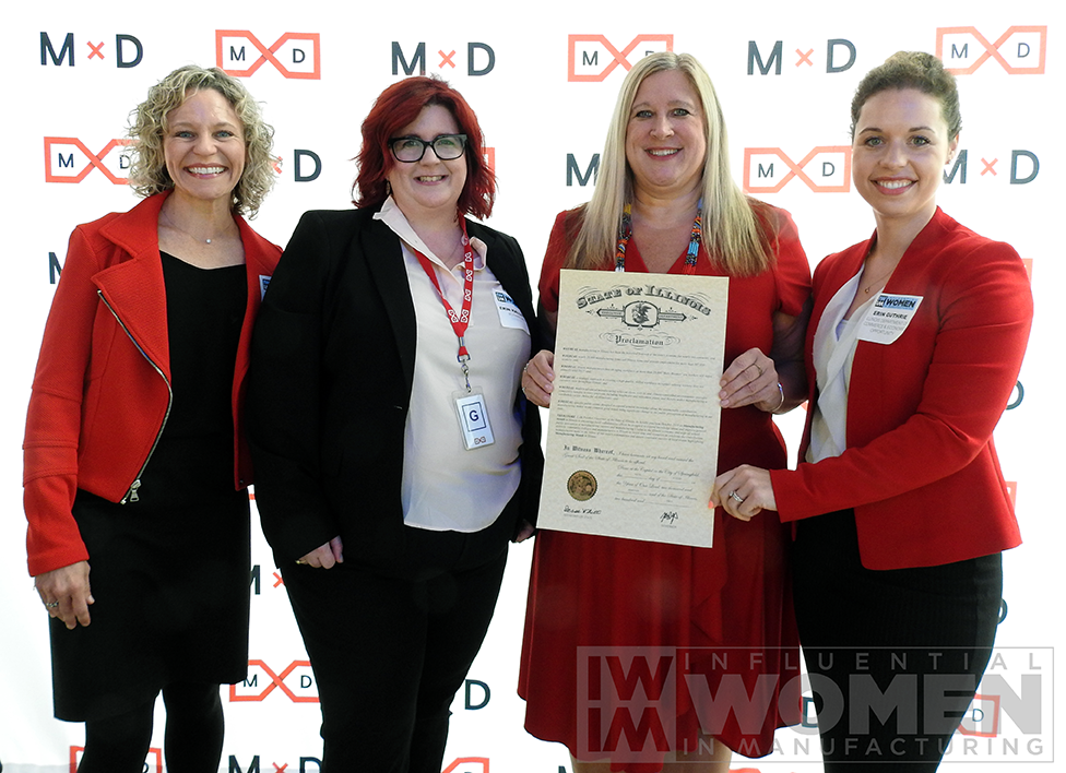 (from left to right) IWIM co-founders Christine LaFave Grace and Erin Hallstrom, MxD CEO Chandra Brown, and director of the Illinois Department of Commerce and Economic Opportunity Erin Guthrie pose with a proclamation from Gov. Pritzker at the awards luncheon on Oct. 4 at MxD.