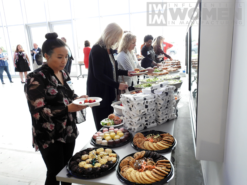 Guests fix plates at the 2019 Influential Women in Manufacturing awards luncheon at MxD on Manufacturing Day, Oct. 4.