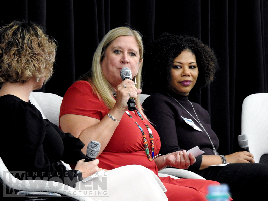 2019 IWIM honoree Chandra Brown (center) of MxD answers questions during a panel, alongside Kate Rome (left) of MxD and Nicole Wiggins (right) of Navistar, at the awards luncheon on Oct. 4 at MxD.