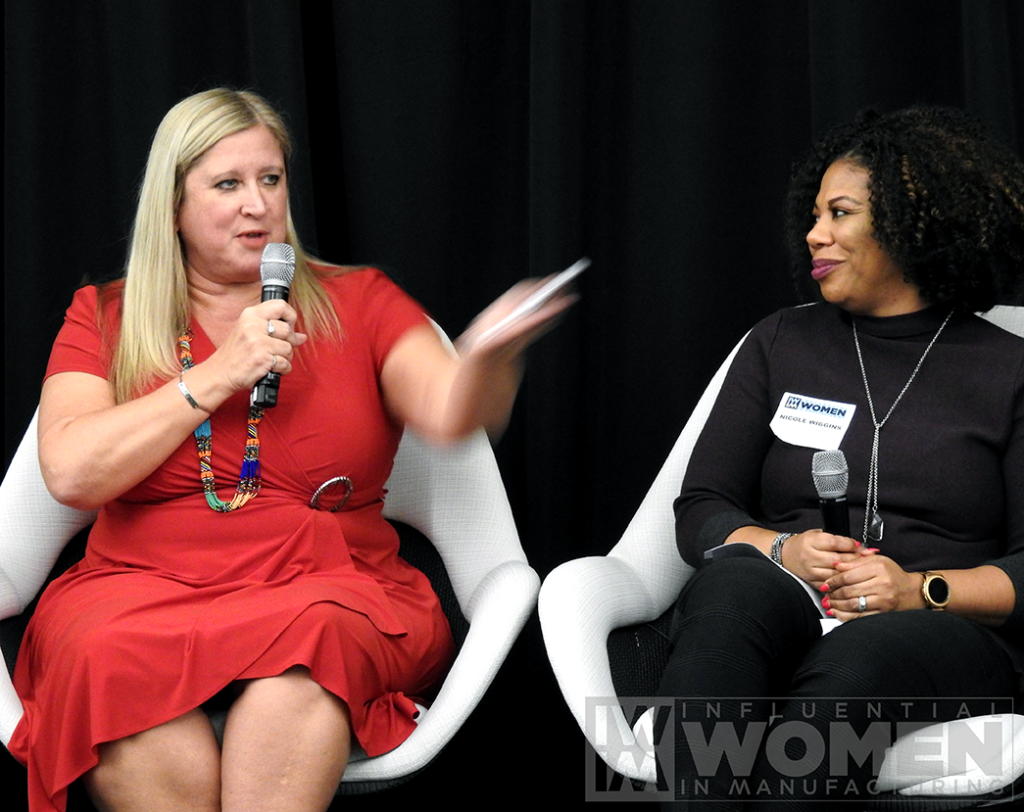 2019 IWIM honoree Chandra Brown of MxD (left) and Nicole Wiggins of Navistar (right) answer questions during a panel at the awards luncheon on Oct. 4 at MxD.