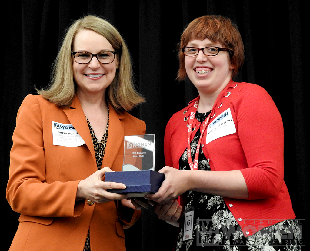 2019 IWIM honoree Sheri Plain of Owensboro Community and Technical College poses for a portrait with IWIM co-founder Alexis Gajewski during the awards luncheon on Manufacturing Day, Oct. 4 at MxD.