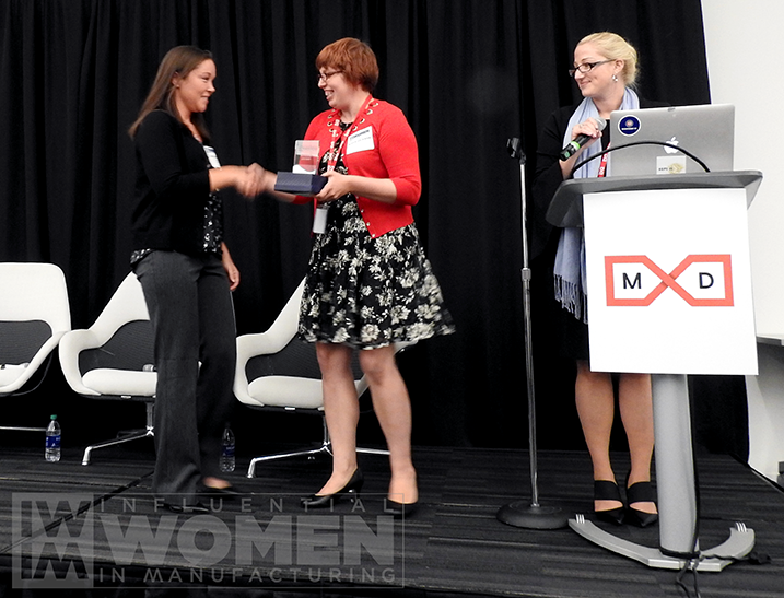 2019 Arial Ruble of Tate & Lyle shakes hands with IWIM co-founder Alexis Gajewski before receiving her award at the IWIM luncheon on Oct. 4.