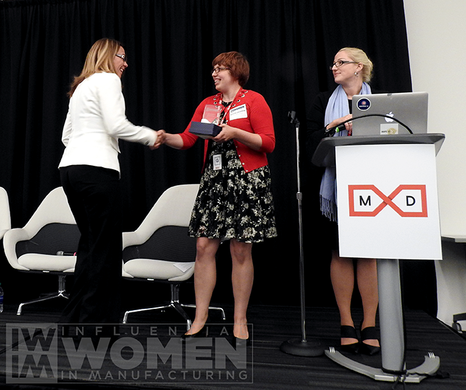 2019 Wendy Smith of Optimation shakes hands with IWIM co-founder Alexis Gajewski before receiving her award at the IWIM luncheon on Oct. 4.