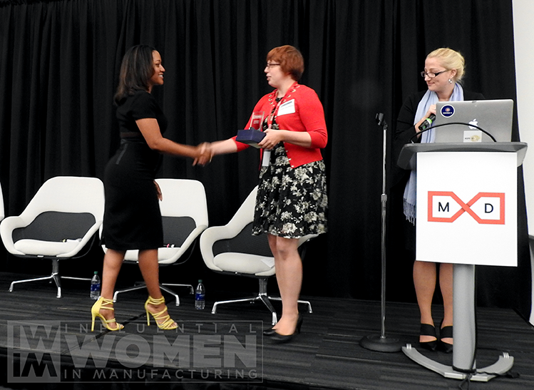 2019 Karla Trotman of Electro Soft, Inc. shakes hands with IWIM co-founder Alexis Gajewski before receiving her award at the IWIM luncheon on Oct. 4.