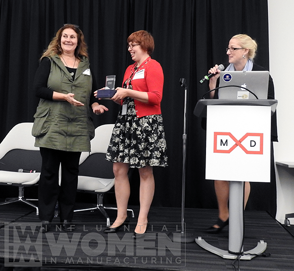 2018 IWIM honoree Marie Getsug shakes hands with IWIM co-founder Alexis Gajewski before receiving an award on behalf of 2019 IWIM honoree Cathy Wilson of Sunair Co. at the IWIM awards luncheon on Oct. 4.